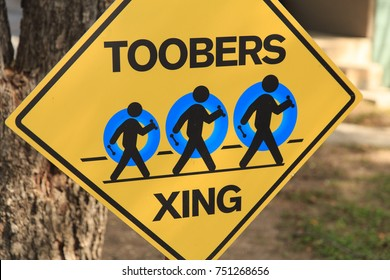 Toobers Xing Sign for people walking across the street to float in the river.