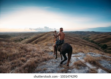 I took this picture in Wairinding Hills, one of Waingapu's district in East Sumba, Indonesia, in September 11 of 2016. One of the popular place to visit and found these horsemen and take his picture.