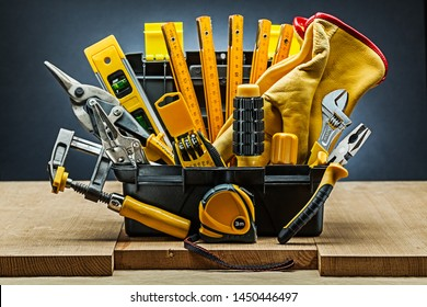tool box wirh many construction tools on wood boards