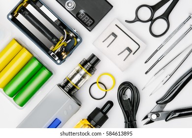 tool kit for maintenance and assembly of modern vaping device mod on white background