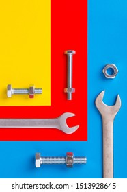 Tool on a colored background close-up. Bolts and nuts with wrenches. Colored background. Bolts and nuts with wrenches. Colored background.