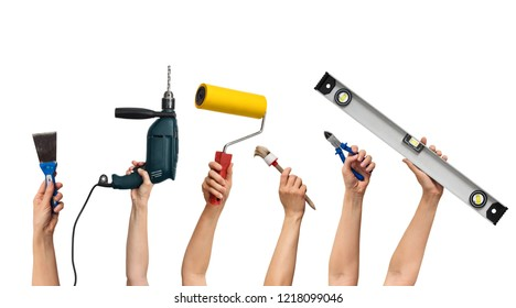 tool set for home repair in hands, on white background