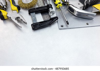 tool set of various instruments for house renovation and hand work on grey metal background