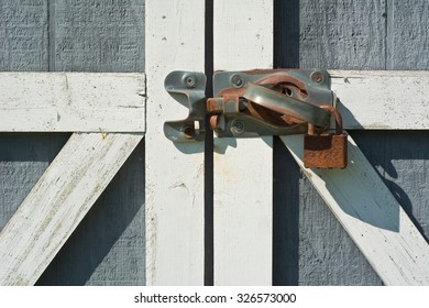 Tool Shed Door with Rusty Lock and Handle