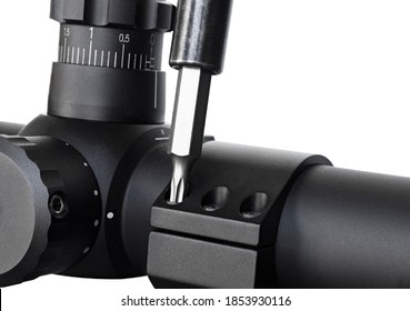 Tool tightening the rings on a hunting rifle scope