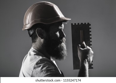 Tool, trowel, handyman, man builder. Mason tools, builder. Bearded man worker, beard, building helmet, hard hat. Builders in hard hat, helmet. Mason plastering. Plastering tools. Black and white.