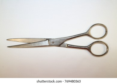 tool for work, simple metal scissors on a white background