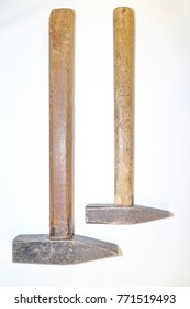 tool for work, two hammers with a wooden handle on a white background