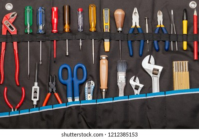 Toolbelt with set of tools - screwdrivers ruler nippers  wrenches pliers pencil  cutter scissors brush chisel - DIY consept