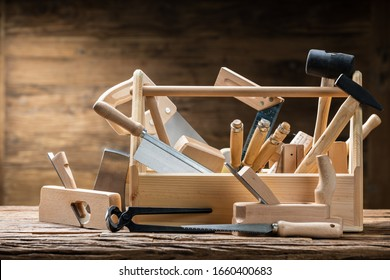 Toolbox With Carpenter Worktools Against Wooden Background