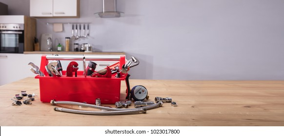 Toolbox With Different Worktools On Wooden Desk