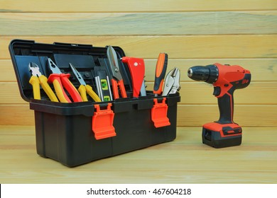 Toolbox with tools. Red toolbox with tools and electric drill.