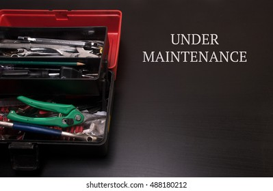 Toolbox with tools wrench, cable cutter, pliers for repairing and servicing copyspace under maintenance