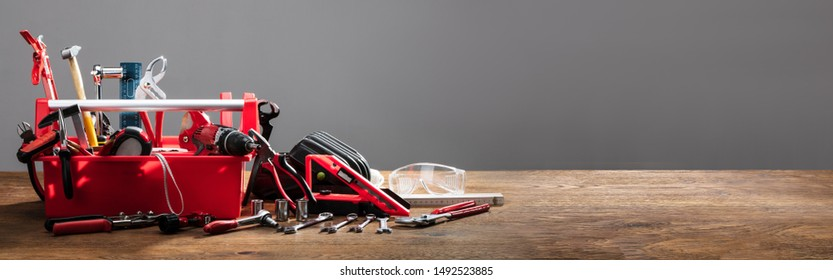 Toolbox With Various Work Tools On Wooden Desk - Shutterstock ID 1492523885