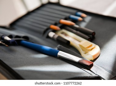 Tools for artist: brush, pencils, toolbox, cutter