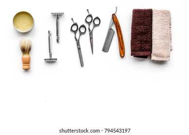 Tools beard and moustaches' care. Razor, brush and sciccors on white background top view copy space