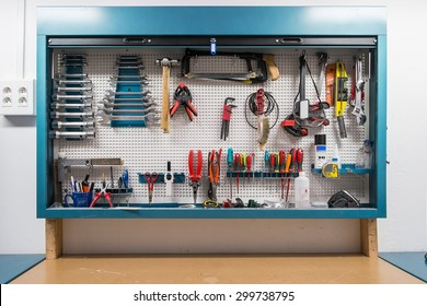 Tools in the board and in workshop. Workshop scene
