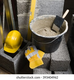 Tools for bricklayer bucket with a solution and a trowel