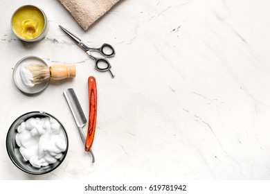 Tools for cutting beard in barbershop on workplace background top view mockup