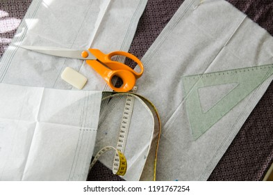 Tools for cutting a piece of fabric - sewing scene