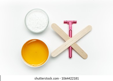 Tools for depilation on a white background, top view, flat lay