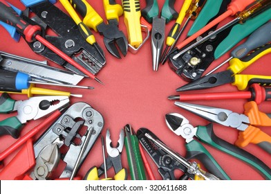 Tools for electrical installation on red metal surface with place on text
