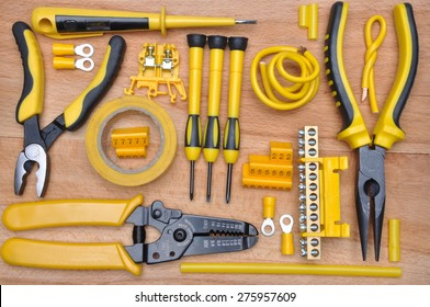 Tools for electrical installation on wooden board