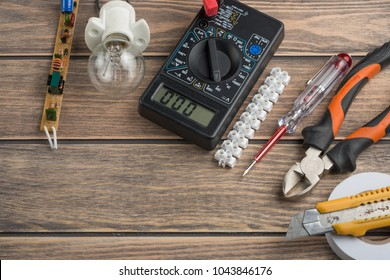 tools for electricians. On a wooden background. View from above, with space for writing or advertising