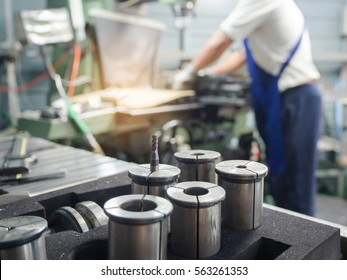 Tools and equipment of milling machine. Blurred of men working background.