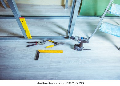 tools and equipment for plasterboard mounting Stack of drywall metal profiles.