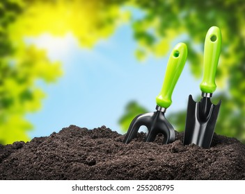 tools garden soil on nature background. Focus on tools