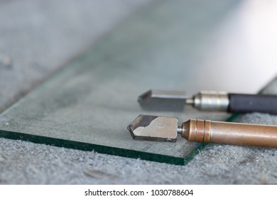 Tools for glass cutters and associated equipment for glass. Used in installing glass fittings.