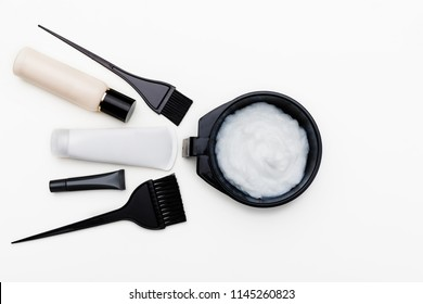 Tools for hair dye. brush, bowl and hair dye in tubes top view