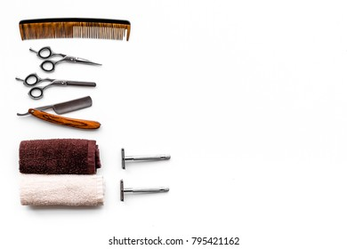 Tools for haircut and shave. Razor, sciccors, brush on white background top view copy space