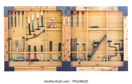Tools hanging on wall in workshop , Tool shelf against a wall isolate on white