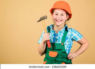 Tools to improve yourself. Builder engineer architect. Future profession. Kid builder girl. Build your future yourself. Initiative child girl hard hat helmet builder worker. Child care development.