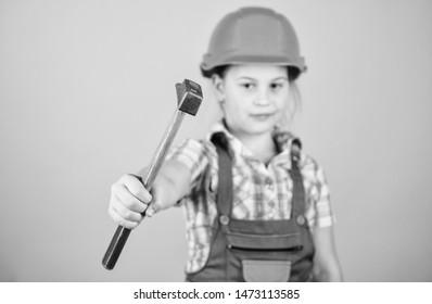 Tools to improve yourself. Child care development. Future profession. Builder engineer architect. Kid builder girl. Build your future yourself. Initiative child girl hard hat helmet builder worker.