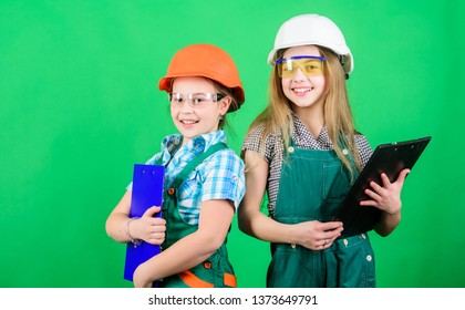 Tools to improve yourself. Repair. Future profession. Builder engineer architect. Kid worker in hard hat. Child care development. small girls repairing together in workshop. Taking care of your home.