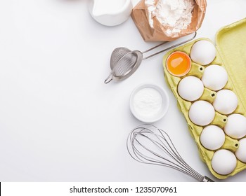 Tools and ingredients for baking: flour, eggs, milk and other. Baking process flat lay