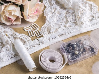 Tools and materials for sewing lace lingerie. Desk tailor master. Creative process moments. Bralette handmade.