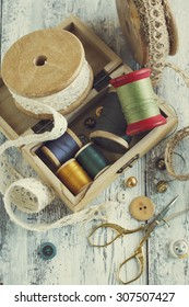 Tools for needlework, thread for sewing, scissors, buttons and v