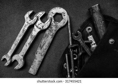 Tools on a pocket on textile background