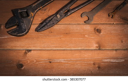tools on wooden background with space for copy