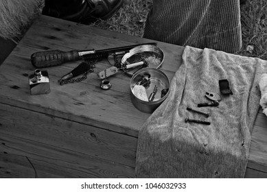 Tools on a wooden table. The photo is in black and white.