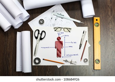 Tools and papers on the table as symbols of business creativity