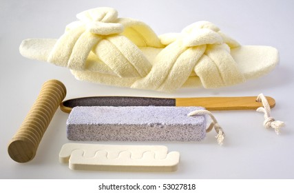 Tools for pedicure over a gray background