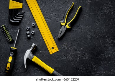 Tools for repairing top view on dark background