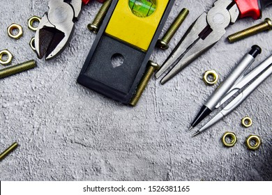 Tools Sets Cutting pliers Wrenches Screwdrivers Pliers Clamps blueprint on Cement Wall Background Construction or electrician architectural Concept