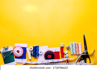 Tools for tailor, instruments for practicing sewing on a yellow background.