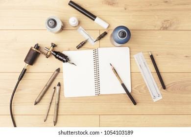 Tools of tattoo artist. Subjects for tattooing. Tattoo studio